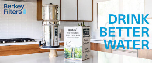 Berkey water filter with box on kitchen counter.