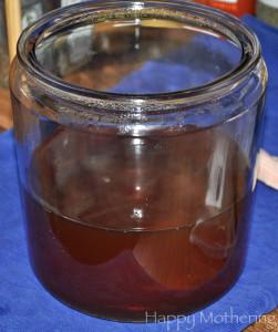 Sugar added to hot tea in glass jar.