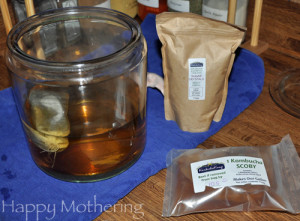 Tea brewing in glass jar on counter.