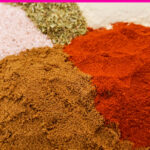 Bowl of cumin, paprika, salt, oregano and garlic powder to make taco seasoning