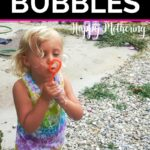 Kaylee blowing a bubble from the DIY bubbles she made