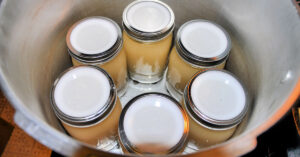 6 quarts of chicken stock in pressure canner ready to be canned.