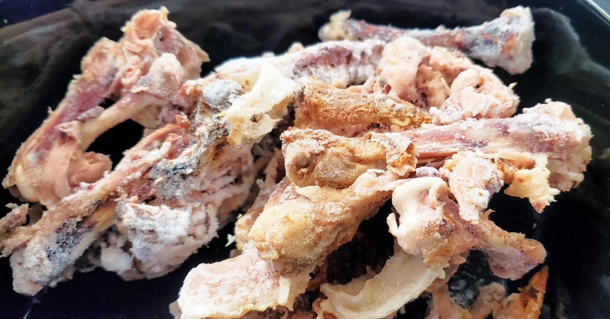 Frozen chicken bones in slow cooker.