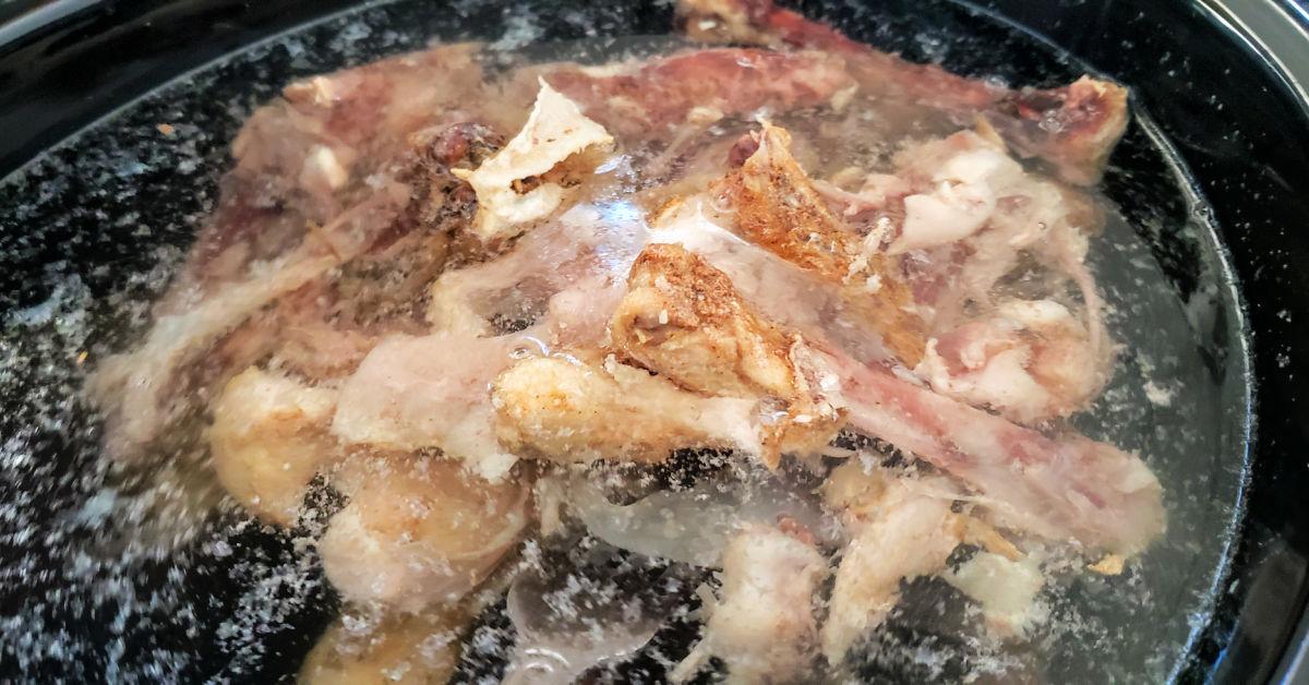 Chicken bones, water, apple cider vinegar and sea salt in slow cooker.