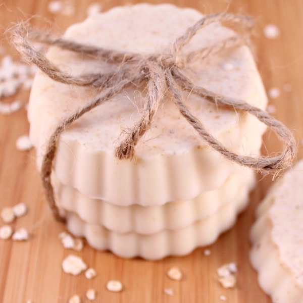 3 exfoliating oatmeal soap bars stacked and tied with twine