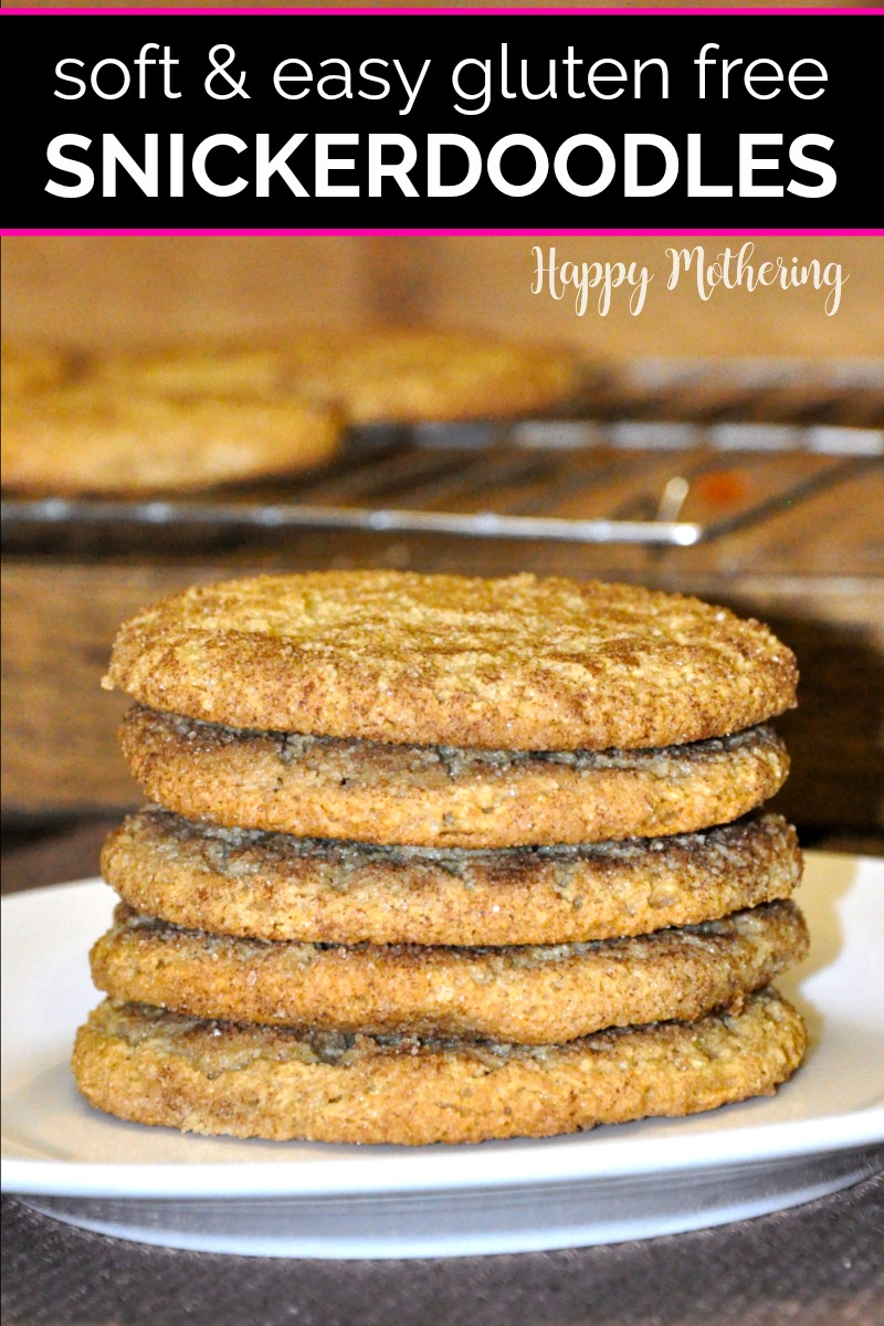 Stack of gluten free snickerdoodles on a plate in front of a cooling rack of cookies