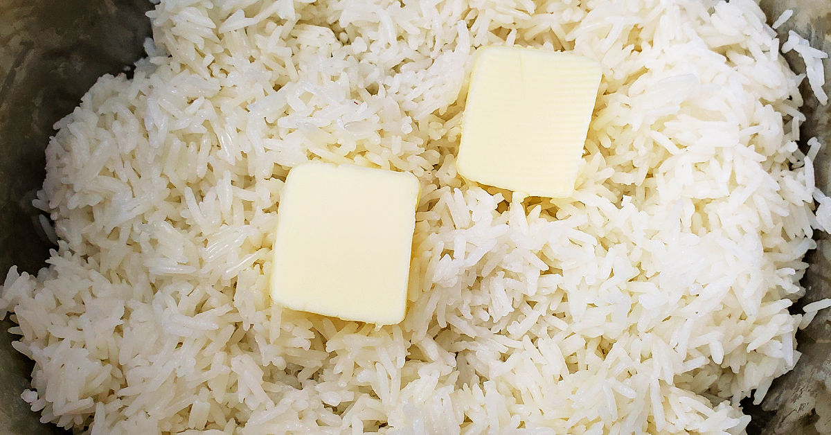 Butter being stirred into plain white rice.