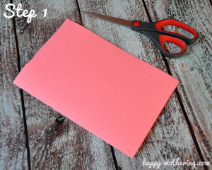 Pink construction paper folded in half