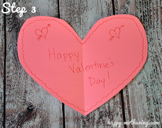 Happy Valentine's Day written on a pink construction paper heart