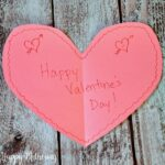 Construction paper heart with Happy Valentine's Day written on it