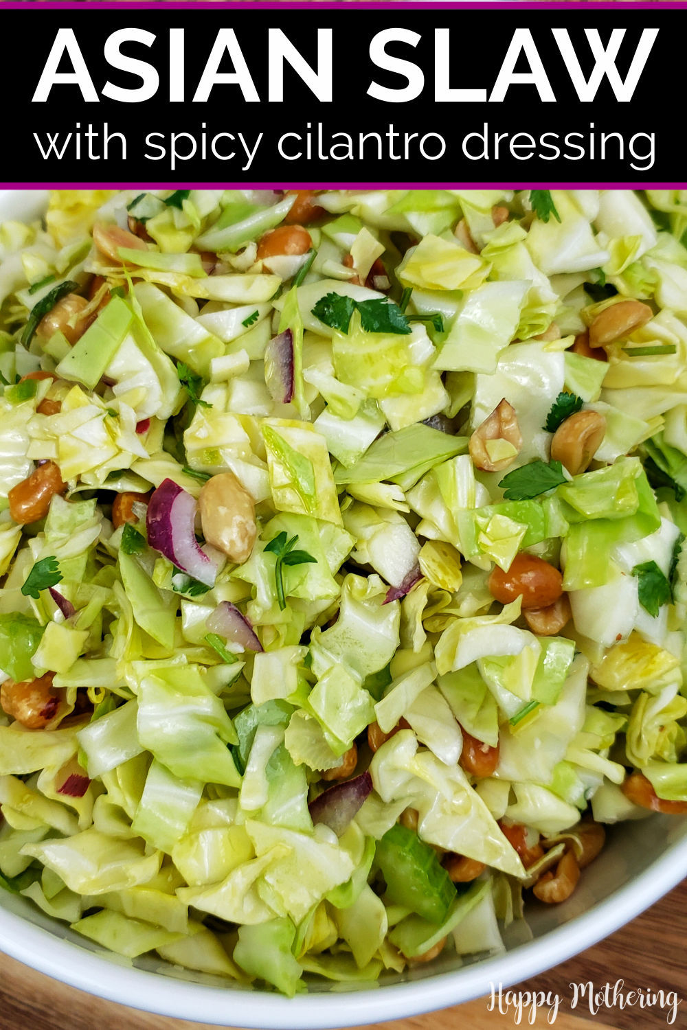 Asian Slaw tossed in spicy cilantro dressing in white serving bowl.