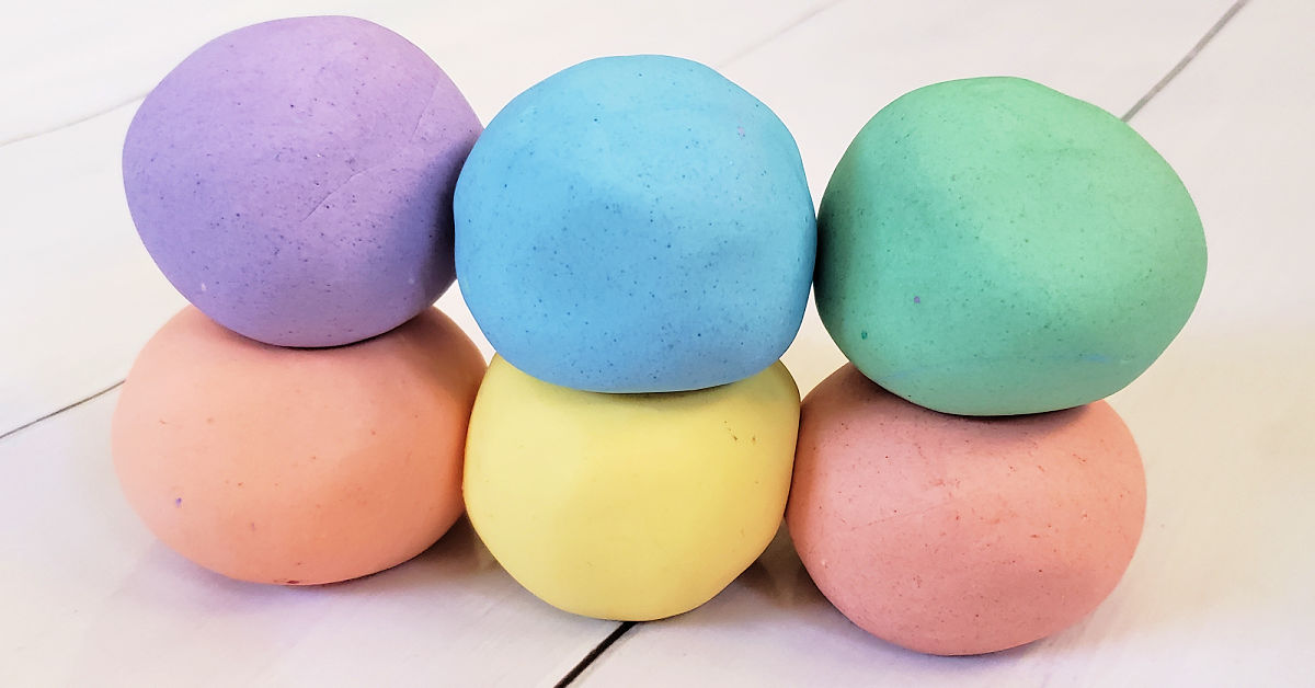 Cloud dough in 6 colors: purple, orange, blue, yellow, green and red.