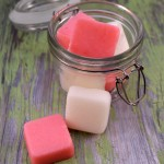 Peppermint sugar scrub bars in a clear glass jar