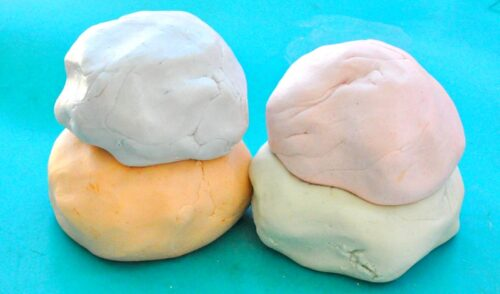two stacks of colorful silky play dough