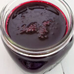 Blueberry syrup in a mason jar on a table