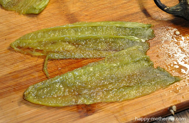 Roasted hatch chiles on a cutting board