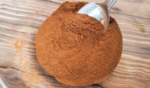Ingredients for pumpkin pie spice being stirred together with a spoon in a small glass mixing bowl