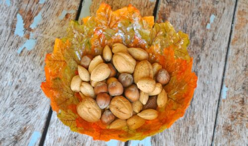 Fall leaves bowl with whole unshelled nuts