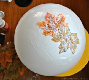 A few leaves glued to a white ballon