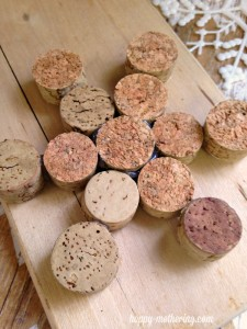 Wine corks glued into a snowflake shape on a wood cutting board