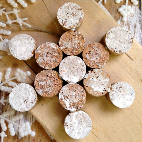 Finished wine cork snowflake with white distressed finish