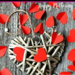 Wood heart with red paper hearts scattered around it