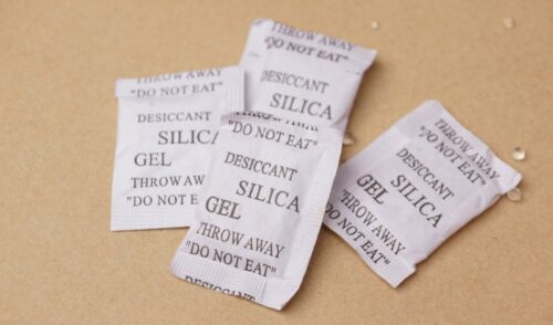 Four silica gel packets on table