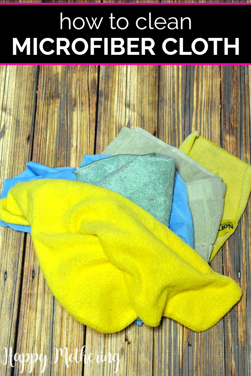 Five microfiber cleaning cloths on a wood table