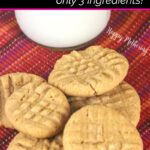 Flourless gluten free peanut butter cookies on red placemat with jar of milk