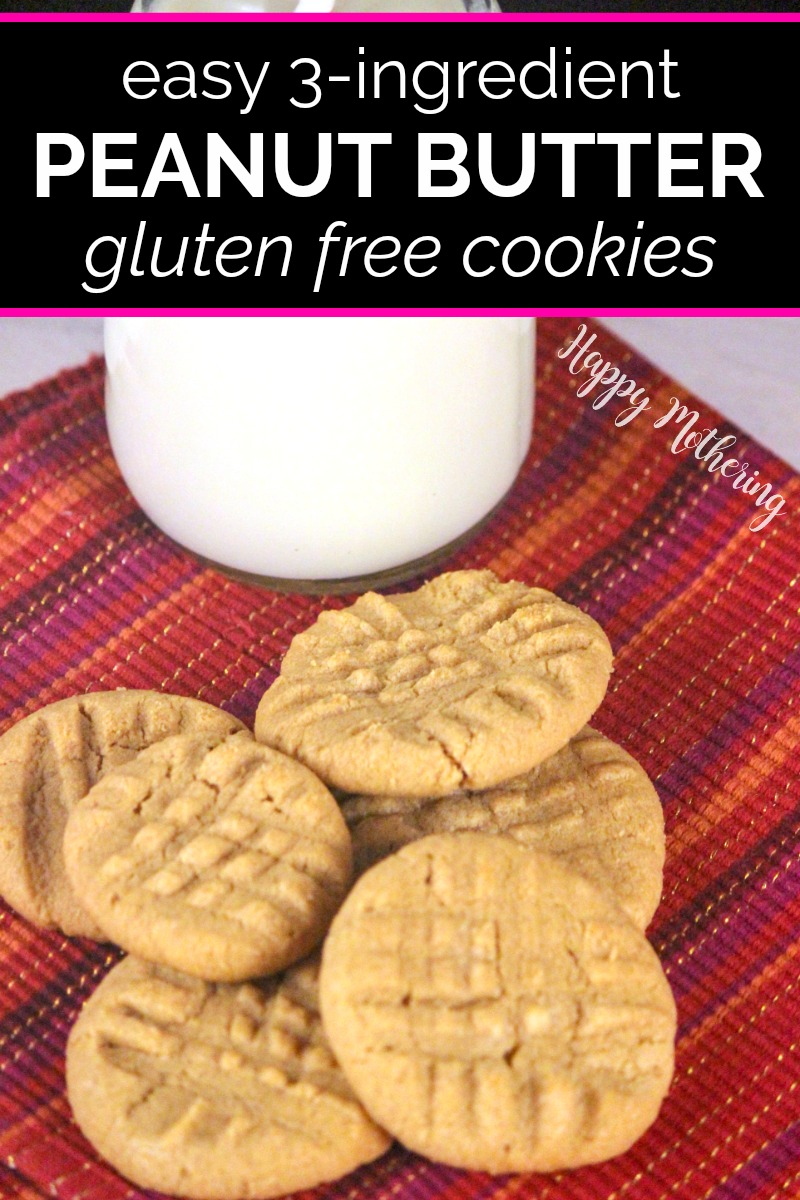 Homemade gluten free peanut butter cookies on a red placemat with milk