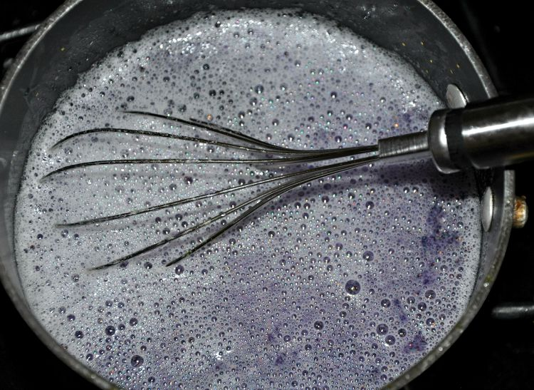 Ingredients to make time out bottle in a pan with a whisk