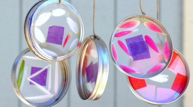 Close up of suncatcher wind chimes hanging on the front porch