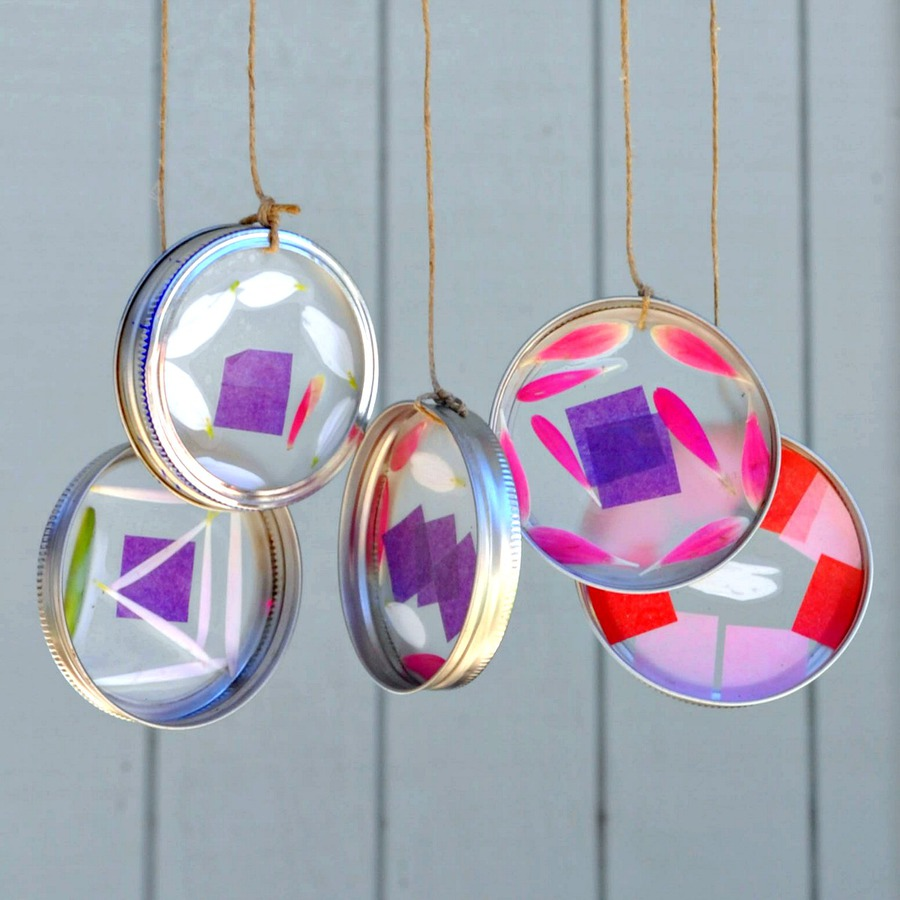 Colorful suncatcher wind chimes made with flower petals and tissue paper