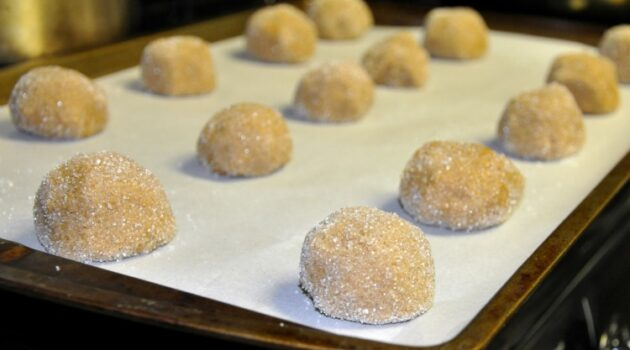 Gluten free gingersnap balls on a baking sheet