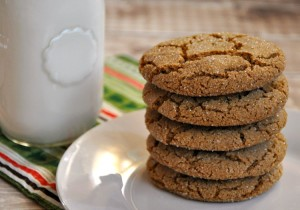 Plate of gingersnap cookies with a small jar of milk ready to eat