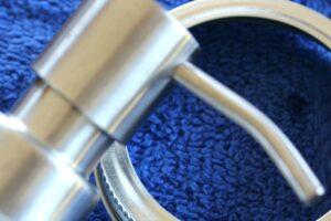 Mason jar soap pump fixture on blue towel