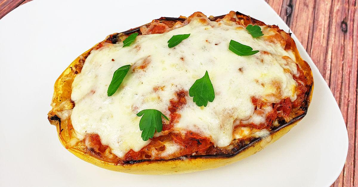 Spaghetti squash lasagna boat on a plate.