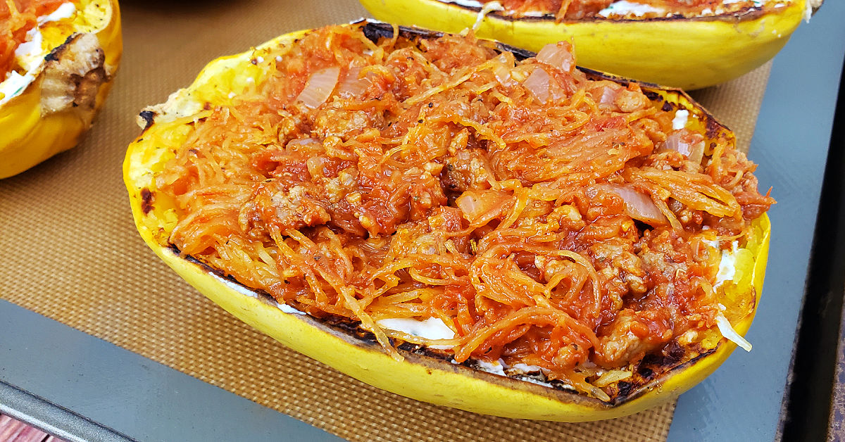 Spaghetti squash halves stuffed with lasagna ingredients.