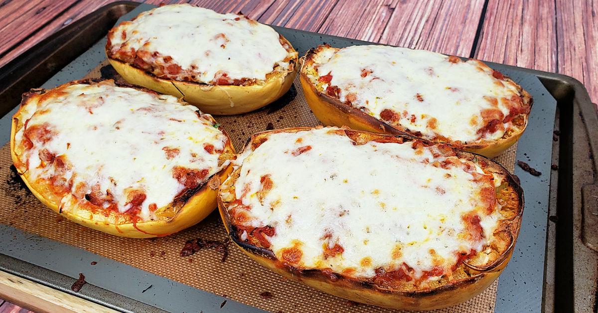 Bubbly melted mozzarella cheese on lasagna spaghetti squash boats.