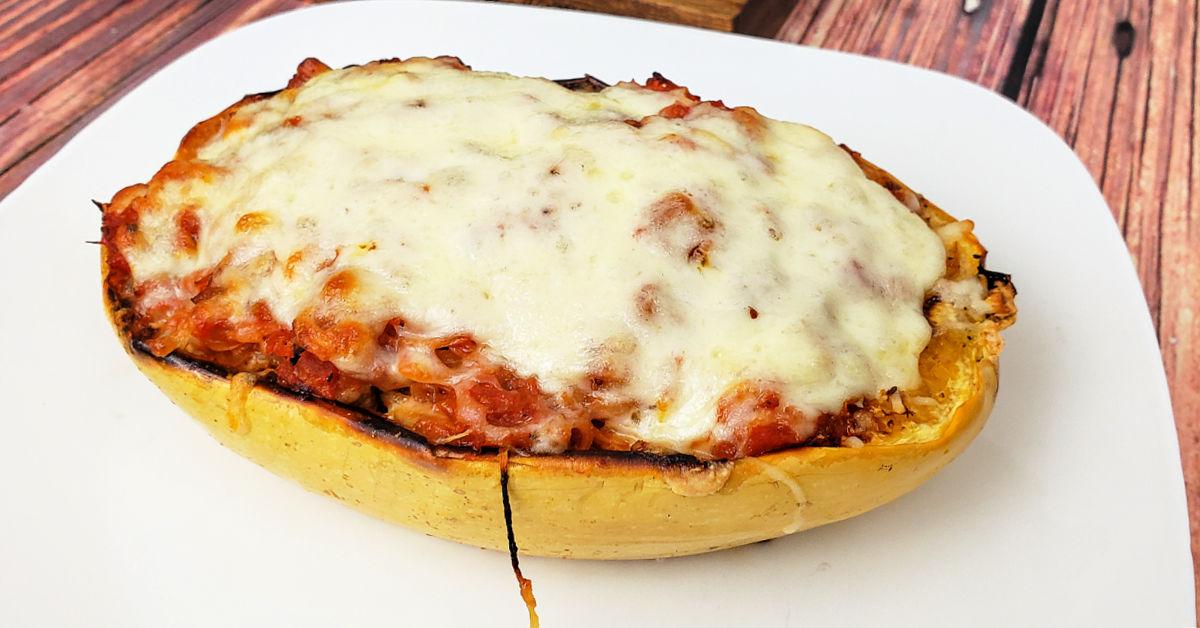 One spaghetti squash lasagna half on a plate.