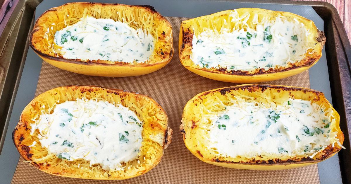 Ricotta mixture spread into spaghetti squash shells.