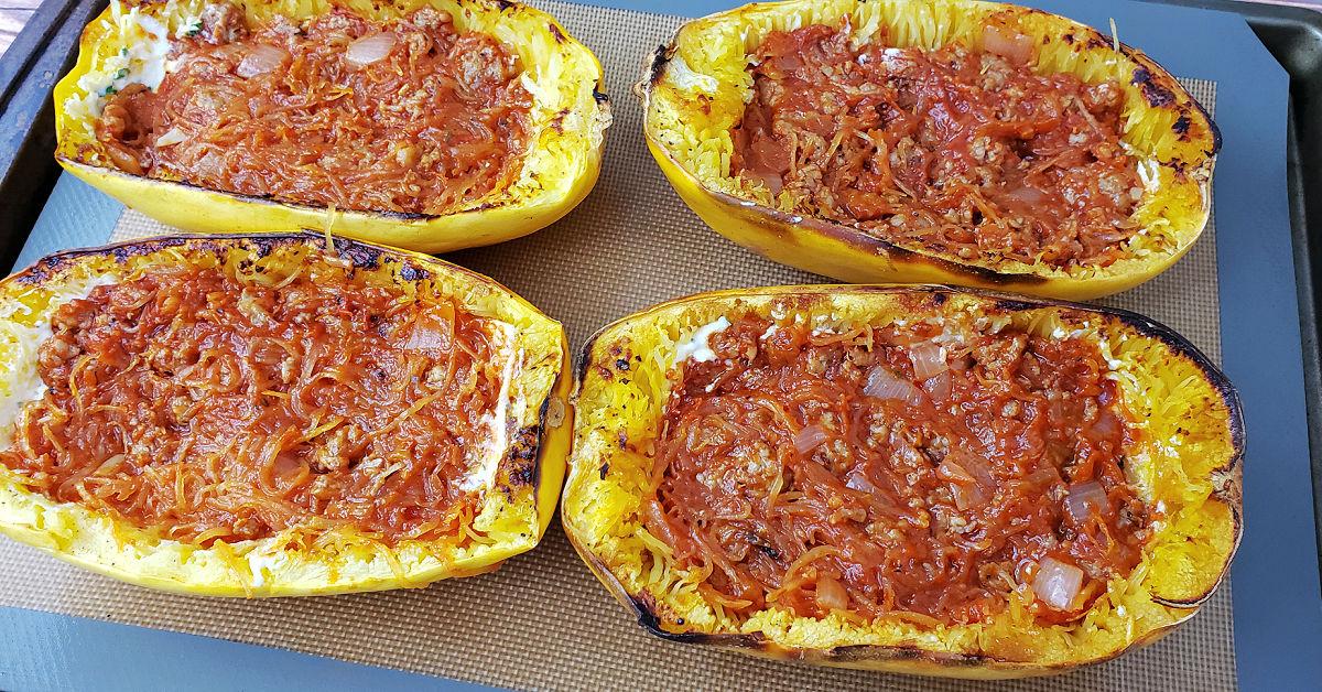 Meat sauce spread over ricotta mixture into spaghetti squash boats.