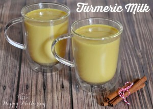 turmeric milk in glass cups on a brown table