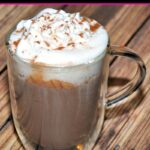 Glass mug of homemade hot chocolate with whipped cream