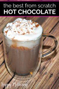 Glass mug of homemade hot chocolate with whipped cream