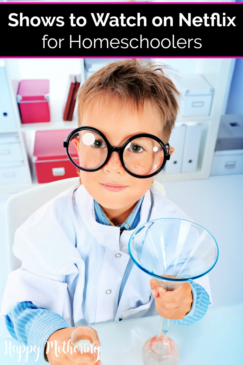 Young boy with oversized glasses in a white lab coat holding a beaker