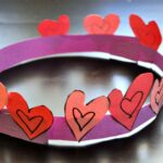 Close up of heart crown made from construction paper for Valentine's Day school craft