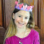 Zoe wearing the crown of hearts she made for Valentine's Day