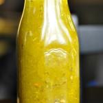 Italian Dressing in a clear glass milk bottle