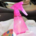 Pink spray bottle of homemade upholstery cleaner